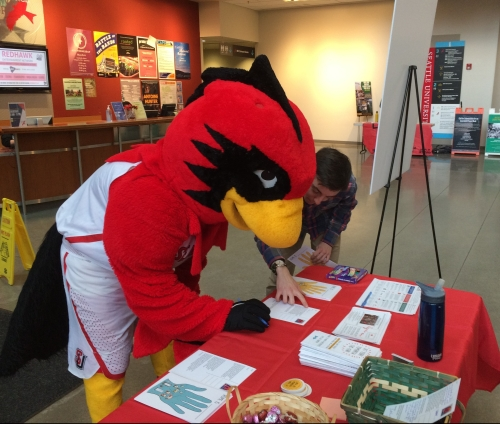 "SU's mascot, Rudy the Redhawk, stopped by our tabling event. ""Home is a warm nest,"" he wrote (with a little help from Connor)."